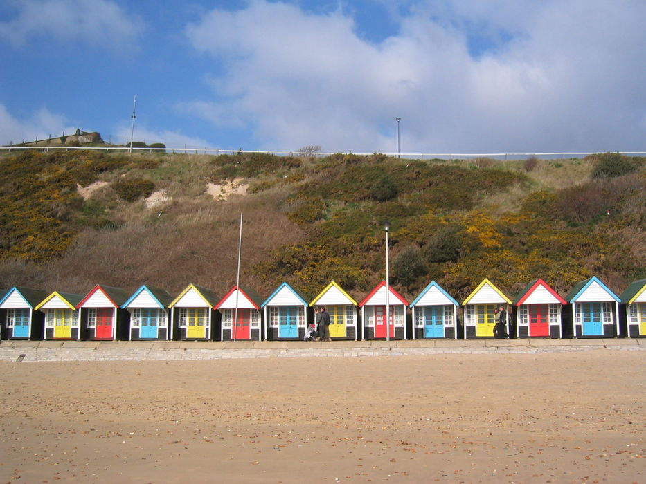Colourful beach huts from the beach at Bournemouth  #moremoneythansense #beachhutrows #hutrows