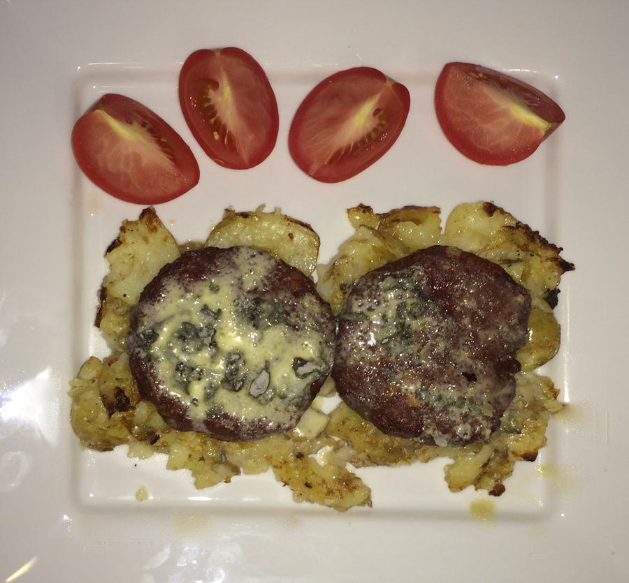 Blue cheese venison burgers on crispy garlic new potatoes