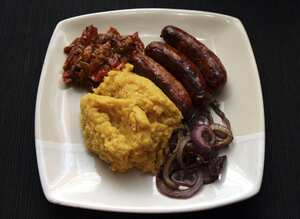 Squash mash with lentils and sausages