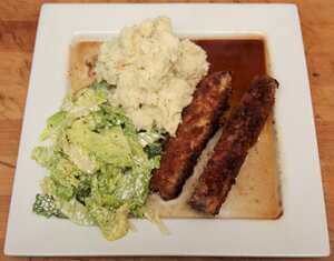 Breaded belly of pork fingers with creamy cabbage and red wine jus