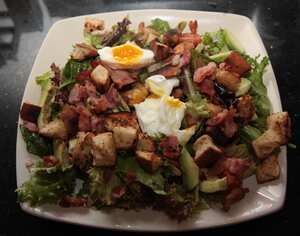 Crispy bacon salad with poached eggs and croutons