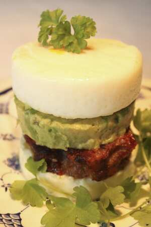 Paleo sausage muffin with smashed avocado