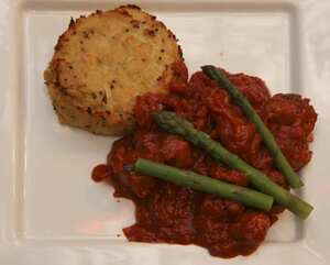 Chorizo meatballs in tomato sauce with bubble and squeak and asparagus