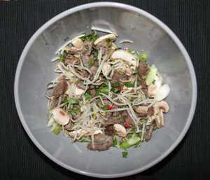 Seared beef and bean sprouts in spicy lime dressing